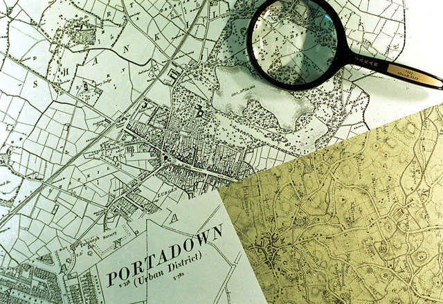 Maps-and-magnifying-glass